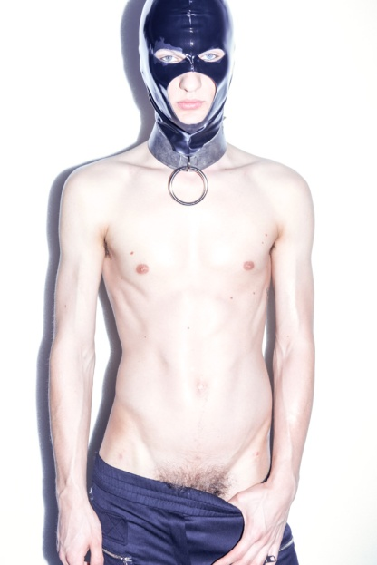 Artur wears tracksuit pants Versus Versace. latex mask stylist's own, leather collar Absidem
