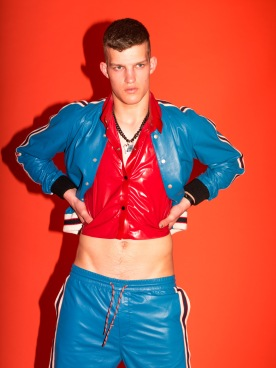 Matteo wears leather tracksuit with embroideries, Gucci, latex crop top Wovo, necklace stylist's own