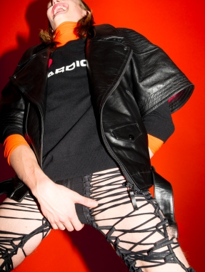 Carl wears short sleeved biker jacket and lace-up jpants KTZ, turtleneck and printed sweater Dior Homme, boots Moschino